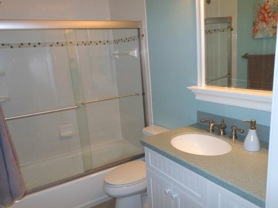 Bathroom with shower tub combo
