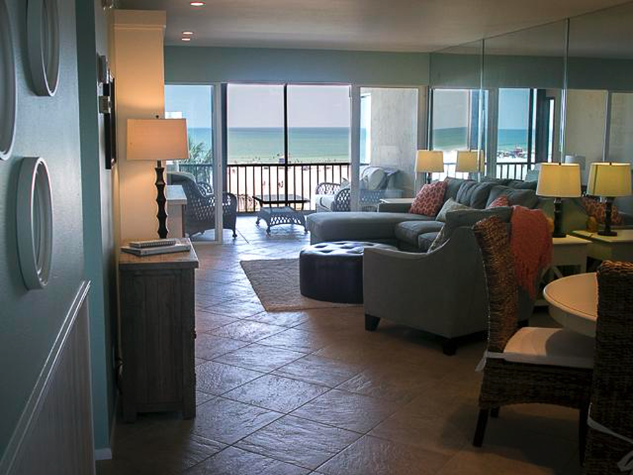 View of living room and verandah with view of Siesta Key Public Beach and the Gulf of Mexico