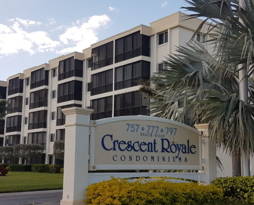 Crescent Royale Condominiums sign on Beach Road