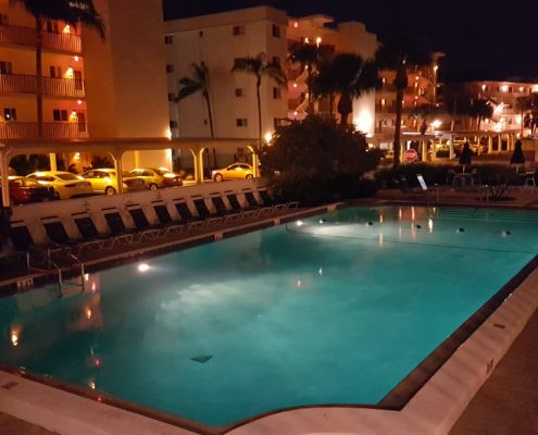 Pool at night at Crescent Royale Condominiums