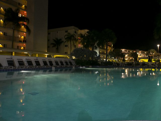 View of the pool at night at Crescent Royale Condominiums in Florida